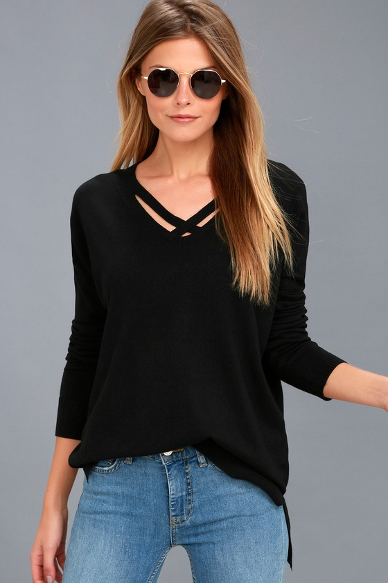 The Lulus Simply Amazing Black Sweater Top is perfect everyday! Soft knit creates a crisscrossing, V-neckline, and long sleeves with ribbed cuffs. Wide-cut, relaxed bodice and notched, high-low hem. Fit: This garment fits true to size. Length: Size small measures 26\