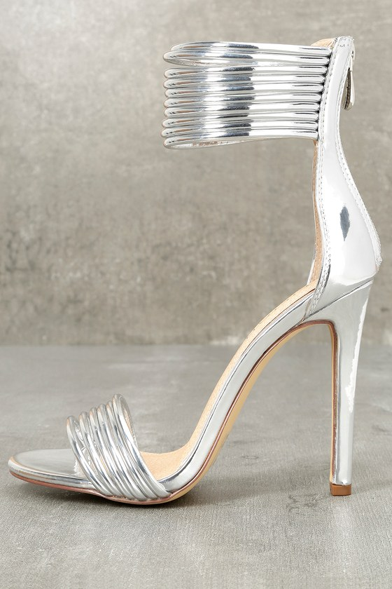 Hudson Silver Patent Ankle Strap Heels