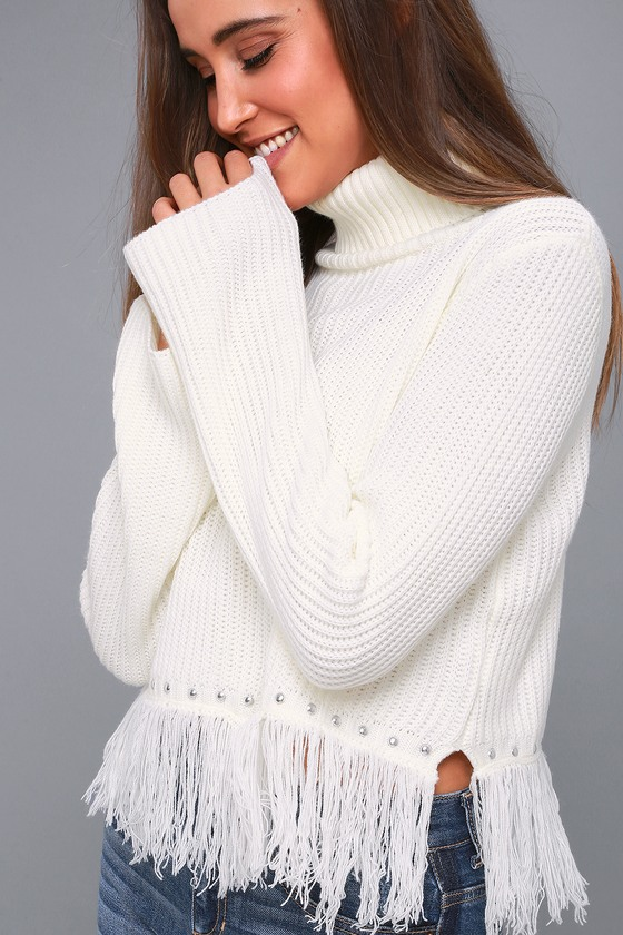 Hit the road in the Lulus Freethinker Cream Fringe Cropped Sweater! Lightweight knit shapes a turtleneck and relaxed, bell sleeves. Wide-cut, cropped bodice ends with trendy silver studs and fringe at the hem. Fit: This garment fits true to size. Length: Size small measures 16\