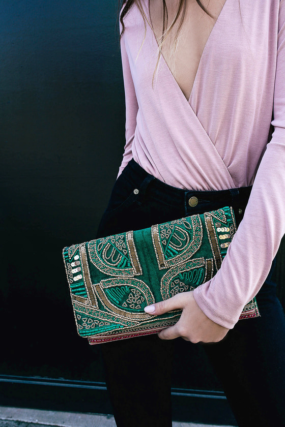 Elegant in every way, the Bead the Best Green Velvet Beaded Clutch will be your fave special occasion accessory! Soft velvet clutch decorated with green and bronze beads and sequins, plus pink embroidered trim. Lift front flap from the magnetic closure to find a roomy interior with side wall pocket. Carry as a clutch, or use the attached 40\