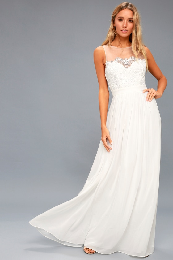 9a406837aba6 The Adette White Lace Maxi Dress makes for an enchanted evening! Sheer mesh  shapes a bateau neckline above a crocheted lace, sweetheart bodice with  darting.