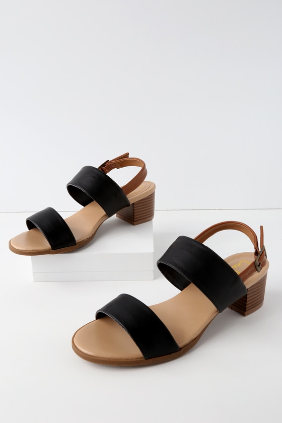 A seaside adventure awaits you and the Lulus Tulum Trek Black Heeled Sandals! Matte black vegan leather toe strap is accompanied by a second black and tan quarter strap with adjustable antiqued gold buckle. 1. 25\