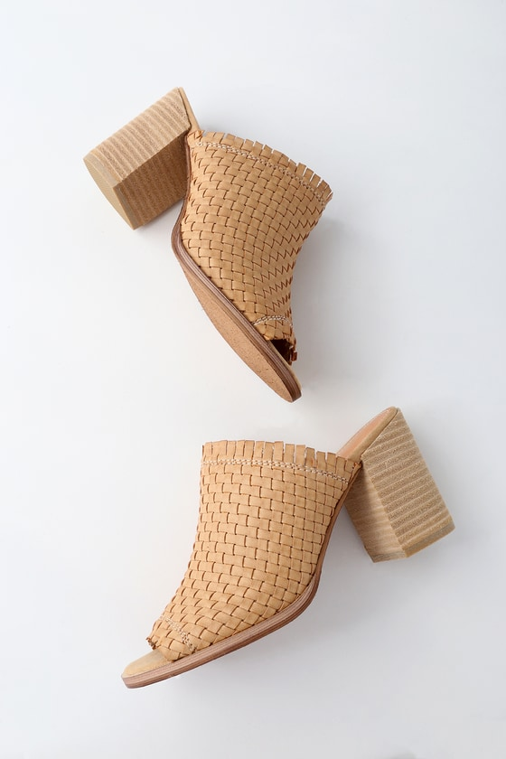 The Rebels Tenley Beige Woven Mules go perfectly with a sundress and a smile! Vegan leather shapes a cute, woven peep-toe upper atop a chunky block heel. 3. 5\
