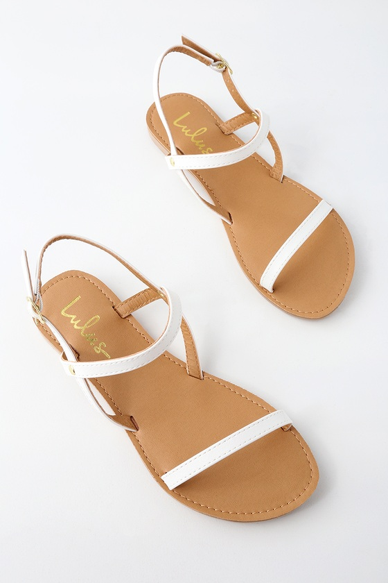 Lulus Exclusive! With the Lulus Rika White Flat Sandals, simplicity has never been more perfect! Vegan leather shapes a peep-toe upper and matching, adjustable quarter strap, with shiny gold buckle. Fit: This garment fits true to size. 0. 25\\\