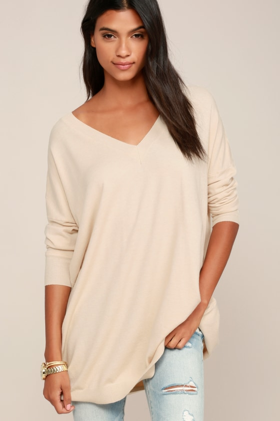 Wherever your travels take you, you\'ll be stylish and comfy in the Lulus Ticket to Cozy Beige Oversized Sweater! Soft and stretchy knit fabric starts at a ribbed V-neck and flows into long sleeves (with ribbed cuffs). An extra long, oversized bodice allows unlimited styling possibilities. Fit: This garment fits true to size. Length: Mid-thigh. Size small/medium measures 31\