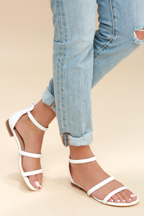 Lulus Exclusive! The Lulus Quin White Flat Sandals are leading the pack in classic style! Sleek vegan leather makes up these essential flat sandals including a peep-toe upper, strappy vamp, and ankle strap with elastic for fit. 3\\\