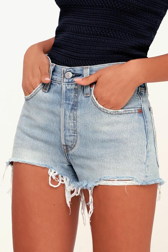 501 Light Blue Distressed Denim Cutoff Shorts by Levi's
