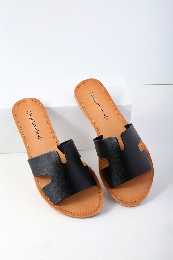 Spend a day in the sun with the Ronnie Black Slide Sandals! Sleek, vegan leather shapes a wide, toe band with notched detail and side cutouts, creating a simple and stylish look that\'s perfect for everyday wear! Slide on design. 0. 25\