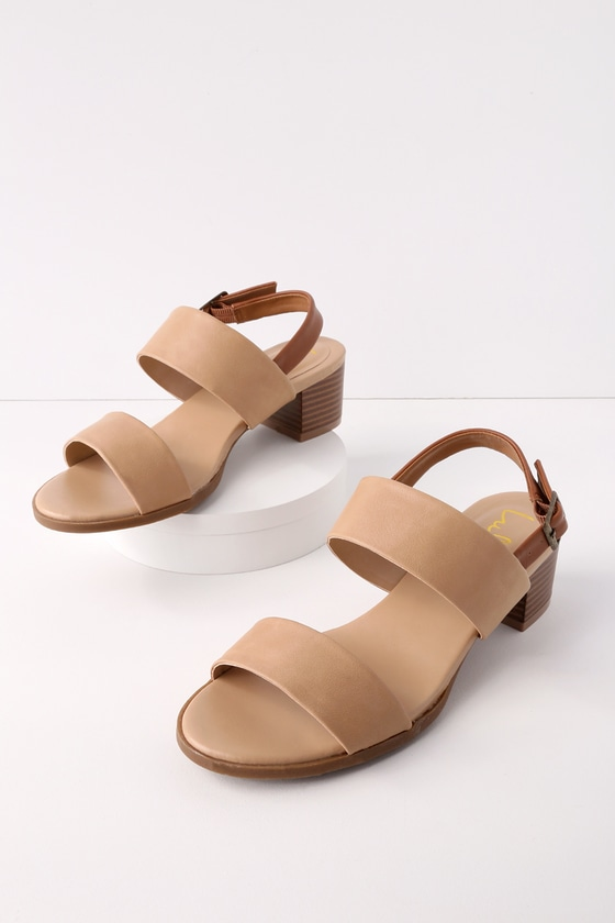 A seaside adventure awaits you and the Lulus Tulum Trek Natural Heeled Sandals! Matte natural brown vegan leather toe strap is accompanied by a matching second strap, and a tan quarter strap with adjustable antiqued gold buckle. Fit: This garment fits true to size. 1. 25\