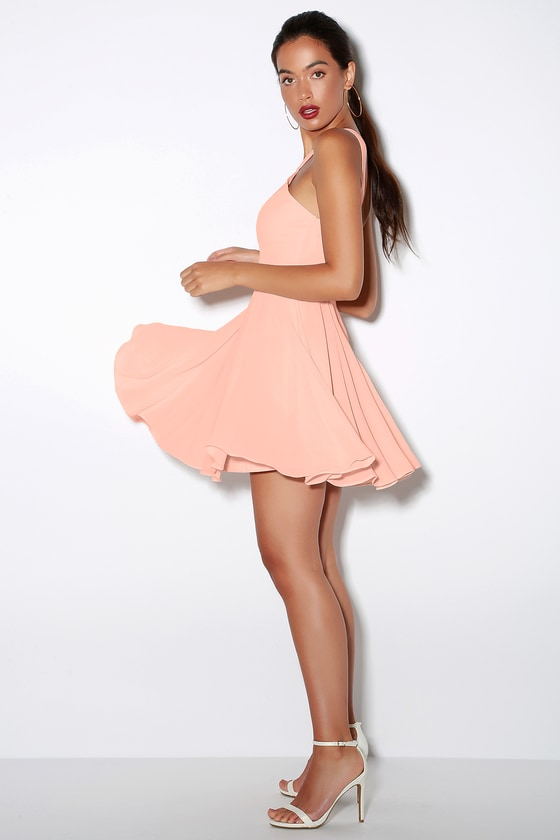 peach dress and gold shoes