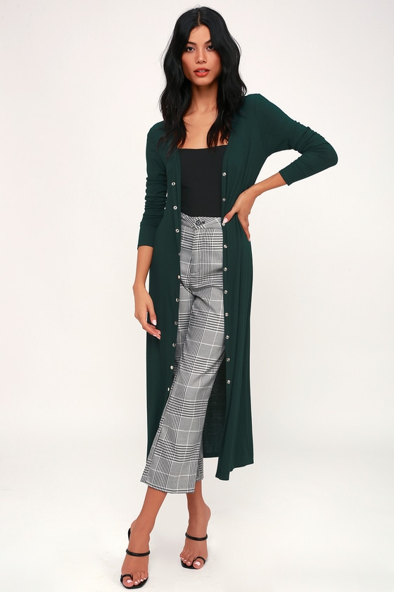 Lulus Exclusive! Your new wardrobe essential is here! Say hello to the Lulus Middleton Forest Green Long Cardigan Sweater! Soft ribbed knit shapes this lightweight cardigan with shiny silver snaps along the longline bodice. Fitted long sleeves frame the look. This versatile piece can also be snapped up and worn as a chic midi dress! Fit: This garment fits true to size. Length: Mid-calf length. Size small measures 45.5\