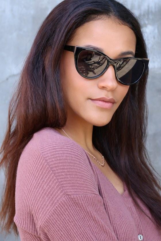 4560d29509 Cool Gold and Black Sunglasses - Flared Sunglasses