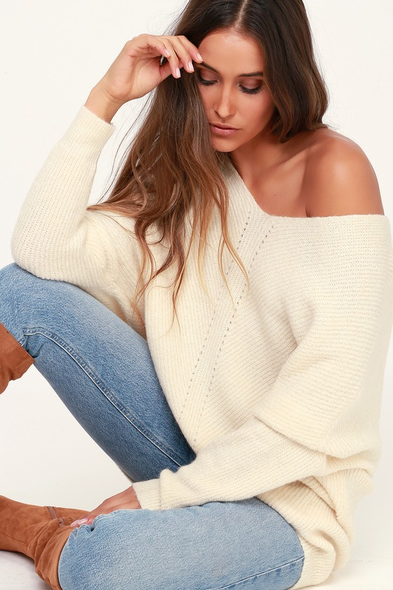 Our new chilly weather staple? The Lulus Emerson Cream Dolman Sleeve Sweater, of course! Plush knit is soft and cozy as it constructs this must-have sweater with a V-neckline and long, dolman style sleeves. Relaxed bodice with stitched details down the mid-line. Ribbed knit accents the neck, sleeves, and slightly high-low hem. Pair this oh-so-soft piece with jeans or leggings for a cozy and cute look. Fit: This garment fits true to size. Length: Size small measures 23.5\