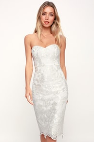 what a knockout white embroidered strapless dress