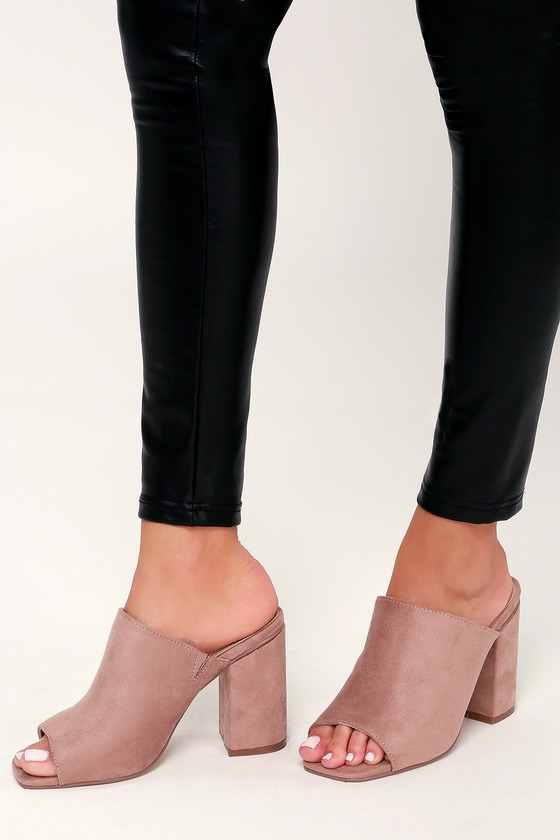 Lulus Exclusive! We are loving the Lulus Raelynn Mauve Suede Peep-Toe Mules styled with so many different looks! From casual to dressy these trendy mules are sure to please with their peep-toe upper atop a sturdy block heel. The soft vegan suede composition can be dressed up or down depending on the occasion. Fit: This garment fits true to size. 4\