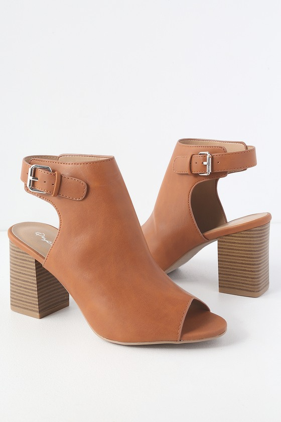 The Otto Rust Peep Toe Booties will make your next night out extra chic! These sleek vegan leather peep-toe booties have a cutout along the heel, and an adjustable ankle strap with a silver buckle. 3\