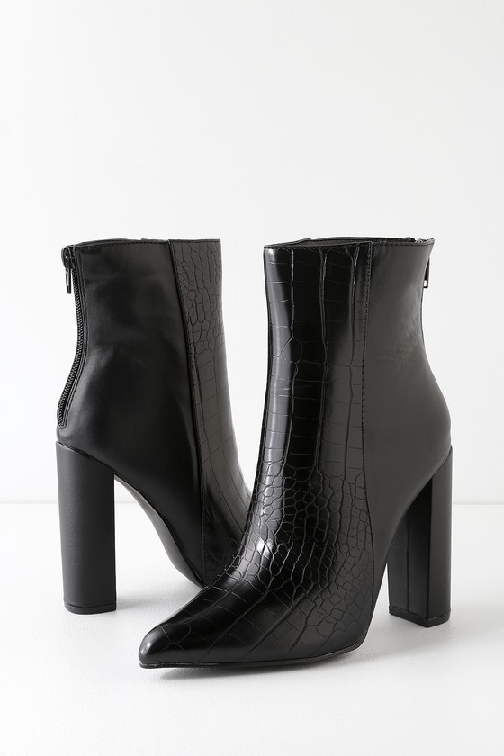 The Lulus Karin Black Crocodile Embossed Two-Tone High Heel Booties are the real deal when it comes to fierce footwear! Crocodile-embossed vegan leather and smooth black vegan leather creates a chic two-tone contrast across these ultra-chic pointed toe booties with an ankle-high shaft and 4.5\