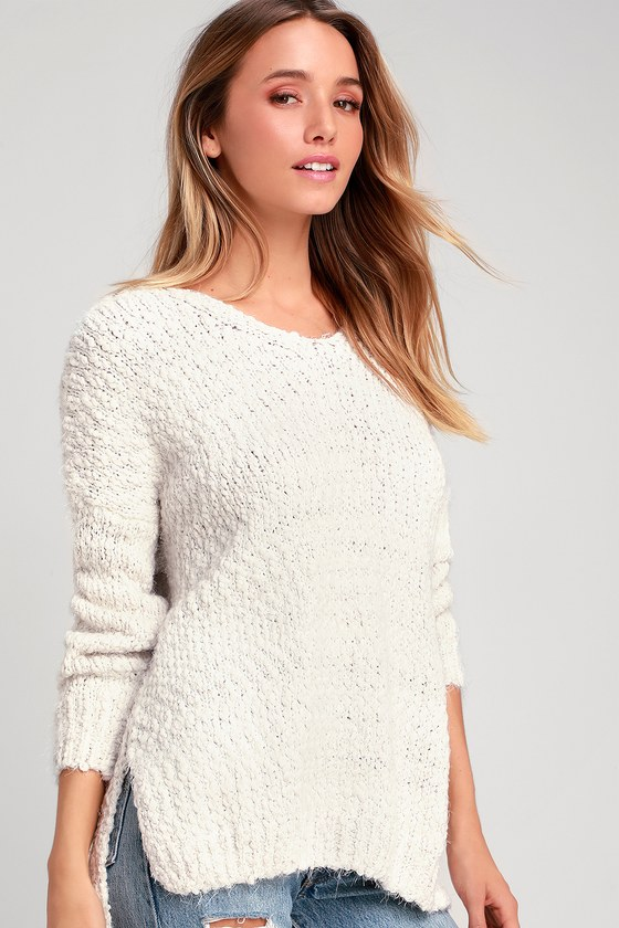 The Lulus Get Cozy Ivory Sweater is just like a snuggly blanket you can take with you all day long! Nubby, fuzzy knit shapes this super soft sweater with long sleeves, a wide V-neckline, and cute notched hems. The slightly oversized and slouchy bodice makes this cuddly top an obvious choice for throwing on over leggings! Fit: This garment fits true to size. Length: Size small measures 25\