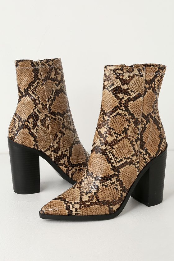 The Essex Tan Snake Mid-Calf Booties are so cute, you\\\'ll want to pair them with every outfit! Shiny vegan leather, in a cool textured snake print, shapes a pointed toe upper and rises into a fitted, 8\\\