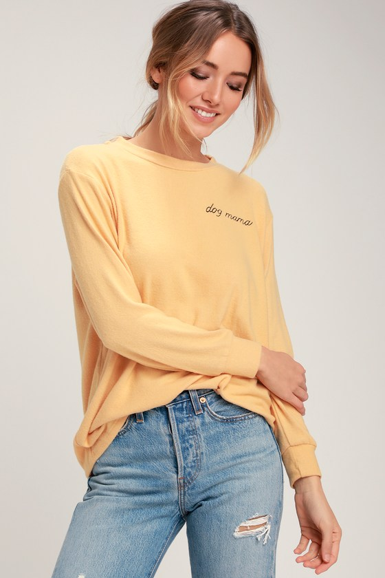 Whether it\'s you or your pet-loving bestie you are shopping for, show some dog mama pride in the Dog Mama Mustard Yellow Sweater Top! This cute sweater top is full of cool casual vibes with its classic crew neckline, long sleeves, and a relaxed bodice with a cute cursive graphic that reads \