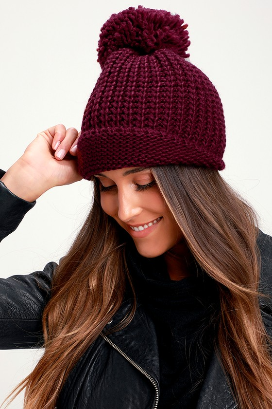 Your cold-weather activities aren\'t complete without the Lulus Lakewood Burgundy Knit Pom Pom Beanie! Chunky knit shapes this classic beanie with a cute matching pom pom at top. Contrasting knit shapes an extra long hem to keep you extra warm! Beanie measures 8.5\