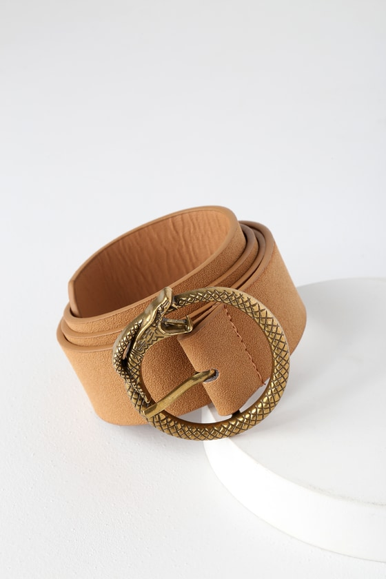 Don\'t let this statement-making belt slither away! The Lulus For Goodness Snake Gold and Camel Belt will add a delightfully edgy touch to any outfit with its uniquely textured vegan leather body and gold snake-shaped buckle. 1. 5\