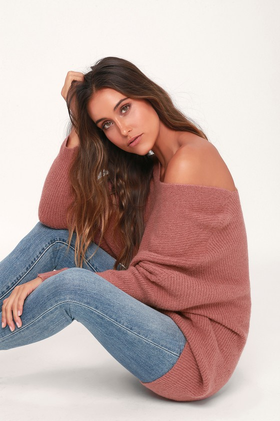 Our new chilly weather staple? The Lulus Emerson Mauve Dolman Sleeve Sweater, of course! Plush knit is soft and cozy as it constructs this must-have sweater with a V-neckline and long, dolman style sleeves. Relaxed bodice with stitched details down the mid-line. Ribbed knit accents the neck, sleeves, and slightly high-low hem. Pair this oh-so-soft piece with jeans or leggings for a cozy and cute look. Fit: This garment fits true to size. Length: Size small measures 23.5\