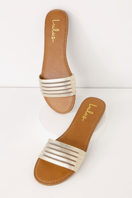 Lulus Exclusive! Step into the summer with the Lulus Addie Gold Elastic Slide Sandal! These adorable slide-on sandals are perfect for a busy gal who has a full vacay itinerary with their wide toe band (composed of stripes of metallic gold elastic) and peep-toe upper. 0. 25\