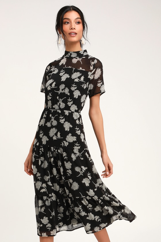Lulus Exclusive! Get a lovely look for an evening out with the Lulus Floral Dressed Up Black Floral Print Midi Dress! Elegant cream and black floral print decorates lightweight woven fabric as it forms a mock neck (with back button closure), sheer decolletage, short sleeves, and a darted bodice. Elastic waist tops a tiered skirt that flows to a modest midi length. Pair with strappy heels and a clutch for the perfect date night \\\'fit! Fit: This garment fits true to size. Length: Mid-calf length. Size small measures 47\\\