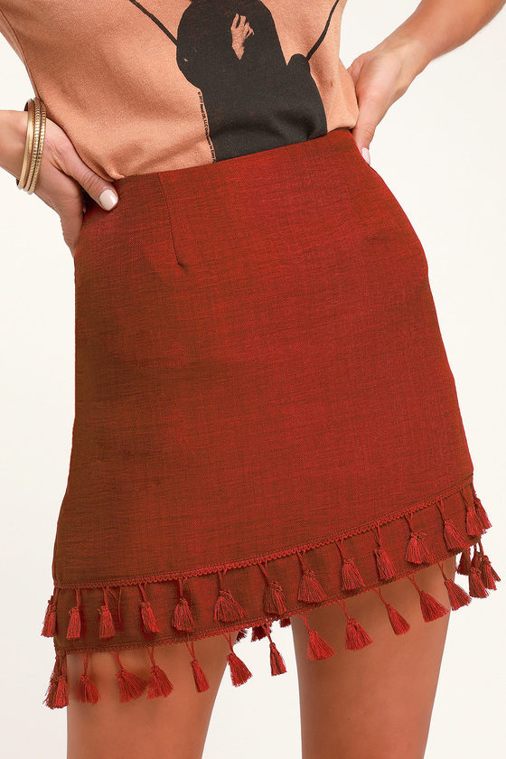 ALL BETS ARE OFF RUST RED TASSEL MINI SKIRT