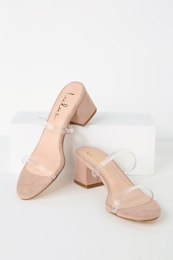 Lulus Exclusive! Get a leg up on the latest trends with the Lulus Savina Mauve Suede Mules! Slender clear vinyl straps top a chic mule silhouette, wrapped in soft vegan suede in a neutral mauve hue. Low block heels make these a comfortable, easy-to-wear option. Dress down with shredded jeans or wear with an LBD for an elevated night out look! Fit: This garment fits true to size. 2. 5\
