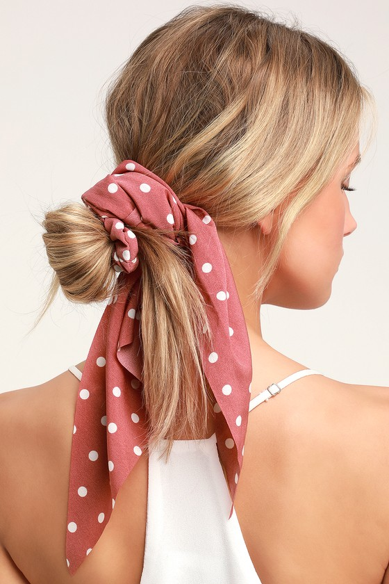 Add a little something sweet to your park day look with the Lulus Soleil Rusty Rose Polka Dot Scarf Ponytail Holder! A cute little polka dot print scarf is tied to an elastic scrunchie hair tie, for an up-do that\'s extra special! Scarf measures 24\