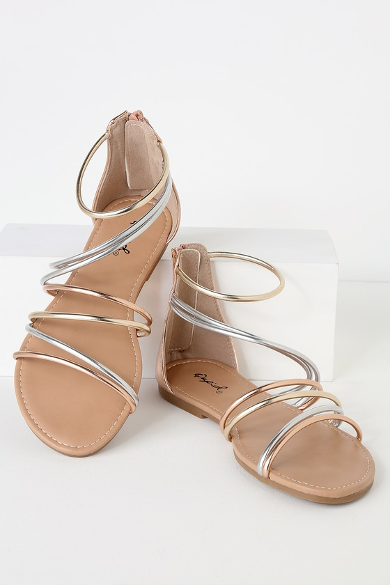 Step into a luxe look with the Charlissa Rose Gold Flat Gladiator Sandals! Rounded vegan leather straps in shades of metallic silver, gold, and rose gold stretch over a peep-toe and climb to a cute, gladiator silhouette. 3.5\