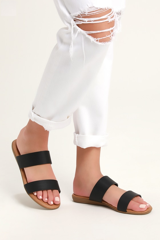 The Lulus Oona Black Slide Sandals are so comfy and cute, we\\\'d walk a thousand miles just to get our hands on them! Vegan leather shapes a two-strap, peep-toe upper. Easy to wear slide-on design with comfy, cushioned insole. Fit: This garment fits true to size. 0. 5\\\
