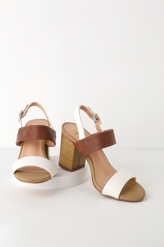 Lulus Exclusive! Lulus Exclusive! Add a splash of fun to your outfit with the Lulus Rowan White and Natural High Heel Sandals! Smooth vegan leather forms a peep-toe upper with a white toe band, a contrasting brown vamp strap, and a white quarter strap with a gold buckle, all atop a sleek single sole silhouette. 3. 5\