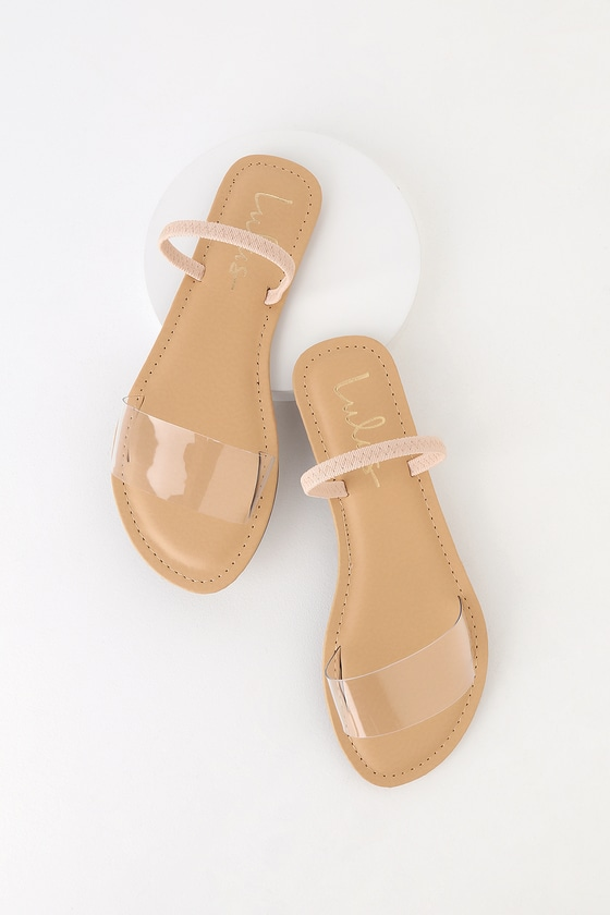 The Lulus Griffith Nude Flat Sandals are the perfect pick-me-up! A trendy clear vinyl toe band and elasticized sling-back strap shape these go-to sandals. Fit: This garment fits true to size. 0. 25\\\