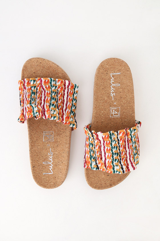 There is only one word to describe our feelings toward the LFL Alexa Bright Multi Slide Sandals, and it is OBSESSED! A smocked, white, burgundy, orange, and green striped toe strap has cute, ruffled trim. A trendy, cork insole completes the chic look. Available in whole sizes only. Smooth cork insole. Rubber sole has nonskid markings. All vegan friendly, man made materials. Imported. Lulus Alexa Bright Multi Slide Sandals Size 6.