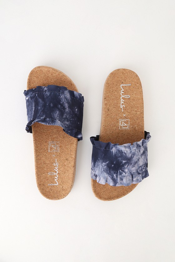 There is only one word to describe our feelings toward the LFL X Lulus Alexa Bue Multi Slide Sandals, and it is OBSESSED! A smocked, blue tie-dye toe strap has cute, ruffled trim. A trendy, cork insole completes the chic look. Available in whole sizes only. Smooth cork insole. Rubber sole has nonskid markings. All vegan friendly, man made materials. Imported. Lulus Alexa Blue Multi Slide Sandals Size 6.