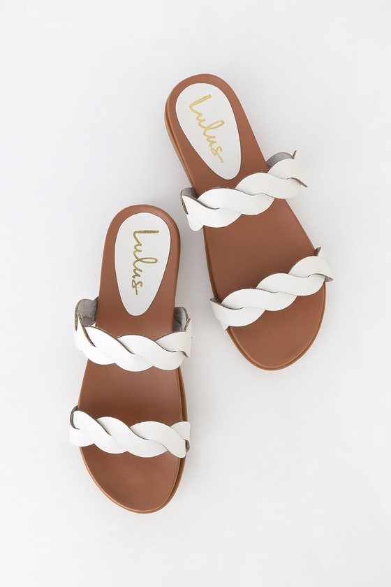 Lulus Exclusive! If on-trend slides have you swooning, you need the Lulus Monica White Slide Sandals in your life! These cool and minimal sandals have two braided, vegan leather straps and a smooth, contoured insole. Slide on design. 0. 25\