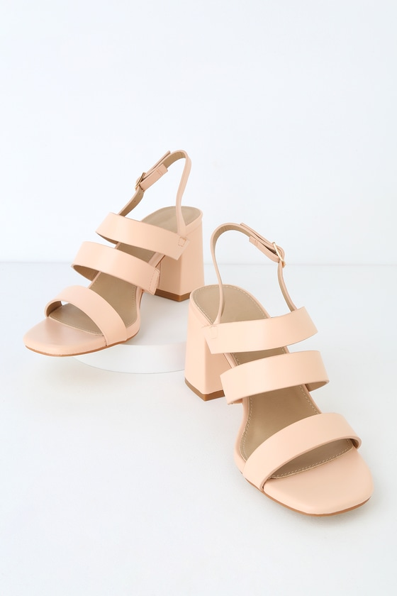 Pair the RAID Bryn Nude High Heel Sandals with a denim mini for the perfect day-out look! Smooth vegan leather creates a toe band, strappy vamp, and matching quarter strap with an adjustable gold buckle. These easy-to-wear sandals can take you from day to night in a flash! Available in European sizes only. 2. 75\