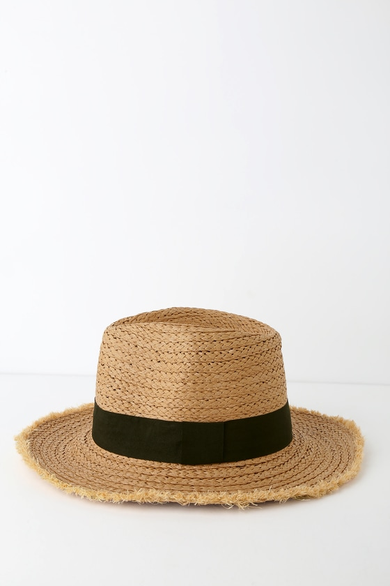 Catch some sun this summer with the Lulus Feelin\' It Tan Woven Boater Hat! This trendy tan woven straw hat features a fedora silhouette, black grosgrain ribbon along the brim, and raw edges for a super chic look. An absolute must-have for the lake this year! 3\