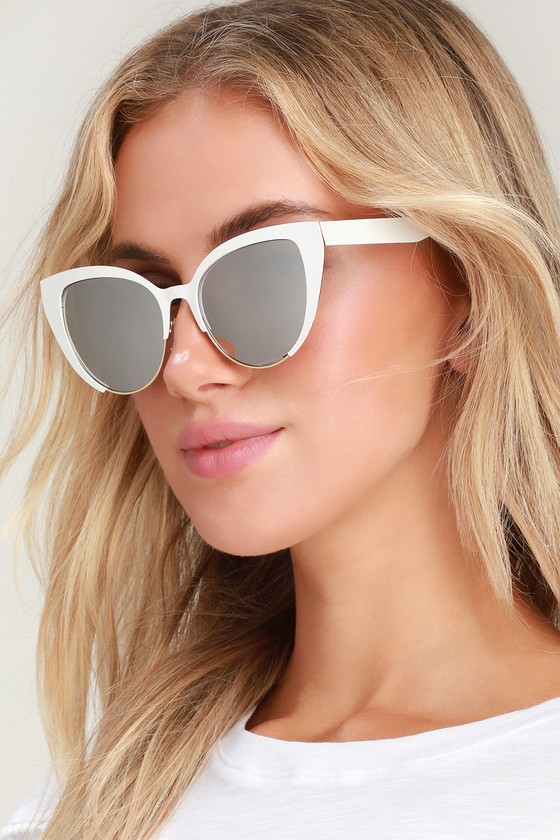 We can\'t get enough of the sassy attitude the Lulus Insatiable White Mirrored Cat-Eye Sunglasses are putting out! A matte white frame creates a partial cat-eye shape (with a sleek peek of gold at the bottom) that houses shiny mirrored lenses. Pair these cuties with a bold lip and plenty of confidence! Frames measure 5. 5\