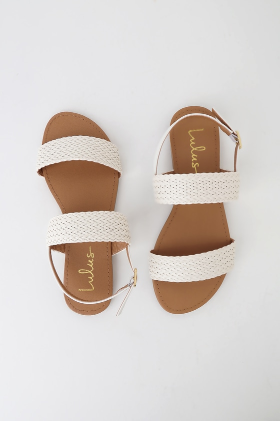 Lulus Exclusive! Shine as bright as a sunny afternoon in the Lulus Blaise White Flat Sandals! Sleek vegan leather shapes a woven toe band and adjustable quarter strap (with gold buckle). Fit: This garment fits true to size. 0. 25\