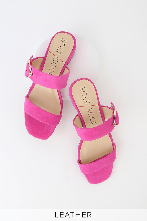 Let your shoes do all the talking when you wear the Sole Society Emberlise Punch Pink Kid Suede Mules! Soft genuine kid suede leather shapes a two-strap, peep-toe upper, and trendy square toe, all atop a matching 1.5\