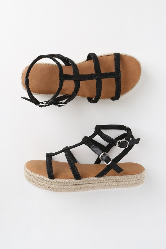 Keep on trekking in the Creekside Black Flatform Espadrille Sandals! A stylish, low gladiator silhouette, composed of cool woven espadrille, forms a peep-toe upper and adjustable ankle straps with silver buckles, all atop a matching espadrille-wrapped flatform, with a white sawtooth sole for a little extra height. 1. 25\
