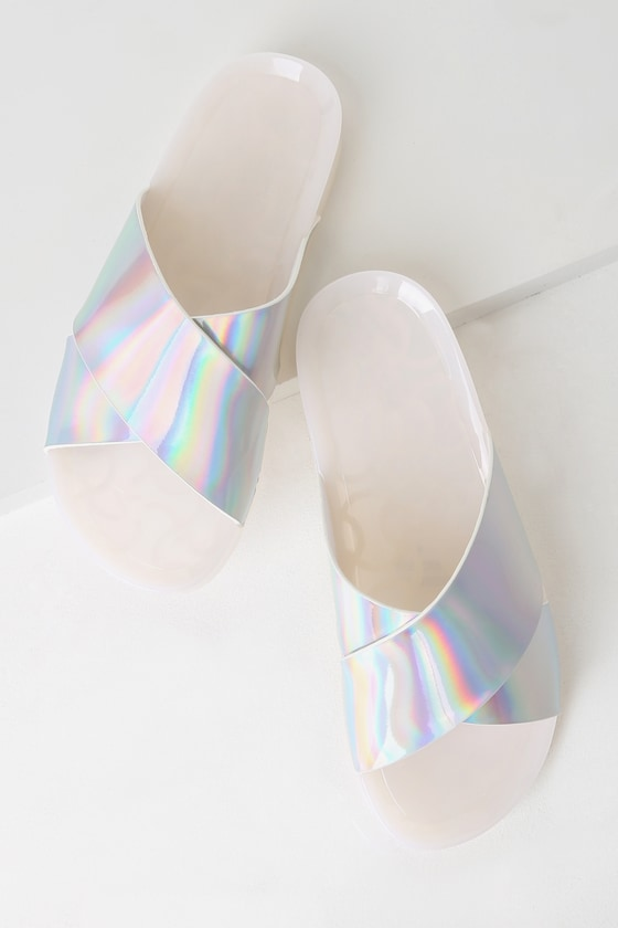 Add some shine to your summer \'fits with the Amanda White Holographic Slide Sandals! These sweet little slides have a slick, 1\