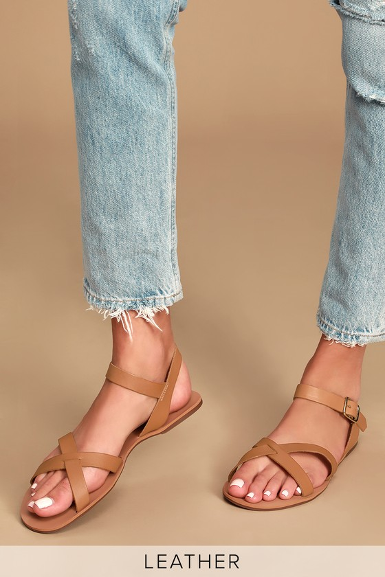 Walk with purpose in the Lulus Calice Cognac Vachetta Leather Flat Sandals! These smooth, genuine vachetta leather sandals are perfect for strolling around town thanks to their simple crisscrossing peep-toe upper and matching quarter strap that secures with a gold buckle. 0. 25\
