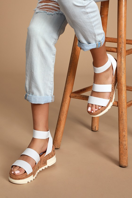 For a shoe that is as unique as you slip into the Steve Madden Bandi White Platform Sandals! A stretchy fabric upper with matching ankle strap rests atop a hybrid cork and rubber platform lug sole for a standout design. 1.5\\\
