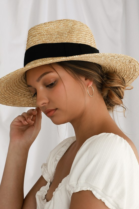 Summer mode is a state of mind and an easy one to maintain in the Brixton Joanna Beige Woven Straw Hat! Natural woven straw shapes this summer-ready fedora with a wide brim and black grosgain ribbon accent. Perfect for pairing with all your fave sundresses! Small measures 4\