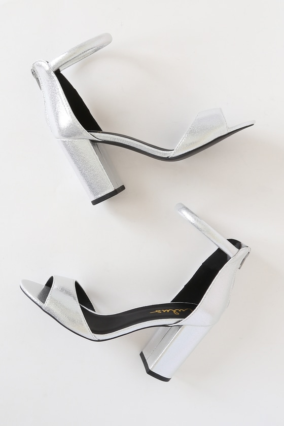 The Lulus Sidecar Cutie Silver Sueded Metallic Ankle Strap Heels are our kind of shoes! These textured metallic fabric heels include a comfy toe band and padded ankle strap. 3\